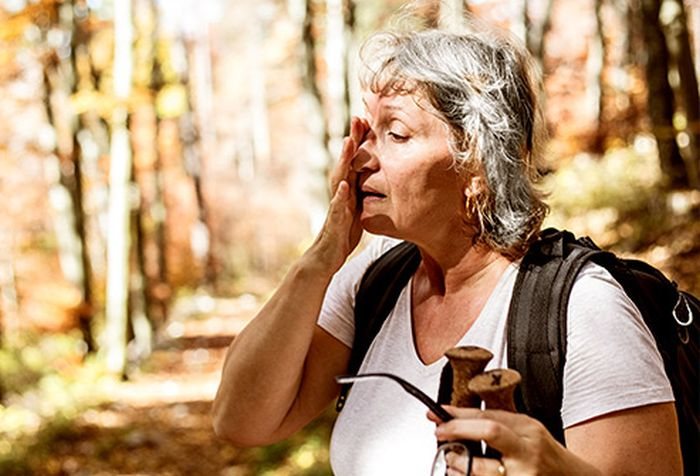 Old Age Woman Sweating During Outdoor Hike